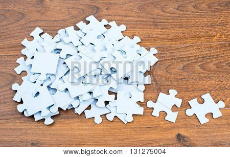 Puzzles on wooden background, close up view