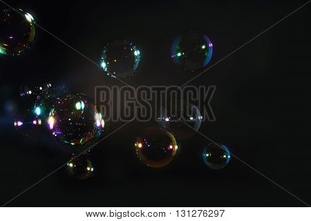 Rainbow soap bubbles on a dark backgrounds