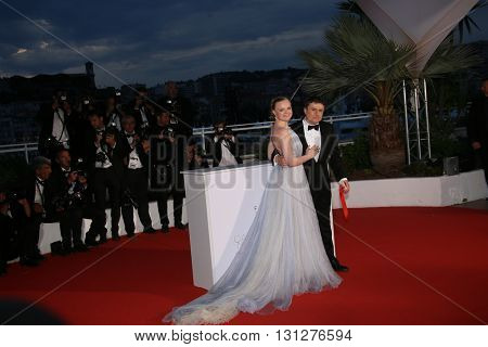 Maria Dragus and Crisitan Mungiu poses  the Palme D'Or Winner Photocall during the 69th annual Cannes Film Festival at the Palais des Festivals on May 22, 2016 in Cannes, France.