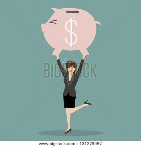Business woman lifting a piggy bank. Business concept