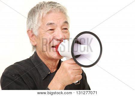 senior Japanese man with megaphone on white background