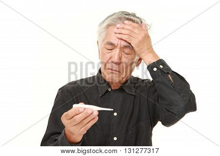 studio shot of senior Japanese man with fever on white background