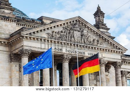 German Reichstag in Berlin, Germany, with flags in foreground