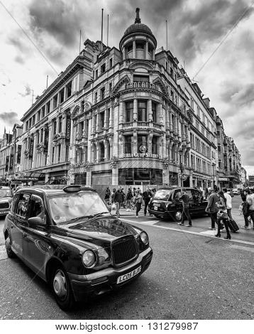 LONDON, UK - AUG 24, 2014: A London Taxi or 'Black Cab' in Piccadilly Circus in black and white.