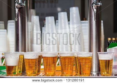 cups with beer at a beer stand