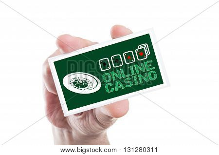 Hand Holding Online Casino Card With Roulette And Four Aces