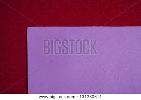 Eva foam ethylene vinyl acetate smooth bright purple surface on red sponge plush background