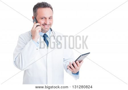 Busy Medic Or Doctor Multitasking With Phone And Tablet