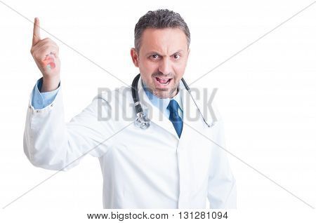 Angry Aggressive Doctor Or Medic Threatening With Syringe