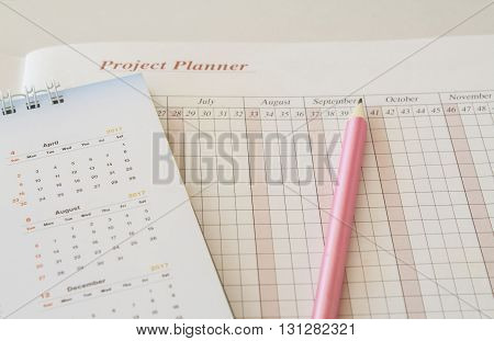 notebook for yearly project planning and finance, control expenses