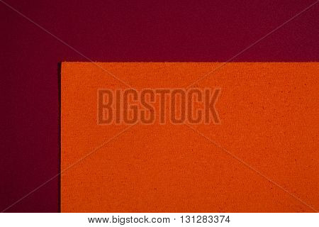 Eva foam ethylene vinyl acetate sponge plush orange surface on red smooth background