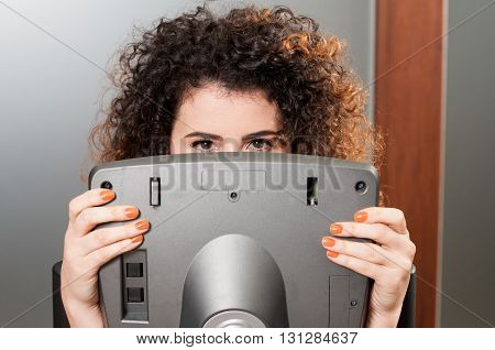 Young Woman Acting Funny And Hiding Behind Stepper Monitor