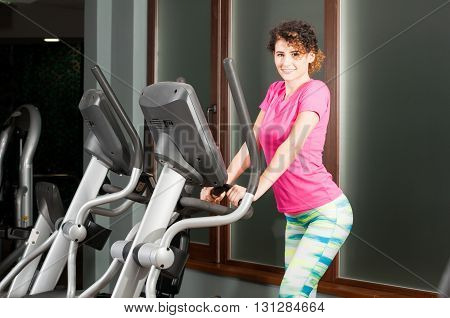 Young Fit Female Training On Stepper Machine