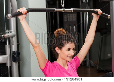 Smiling Beautiful Woman Lifting And Training With The Iron Bar