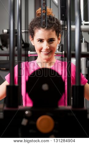 Attractive Female Face Thru Gym Equipment