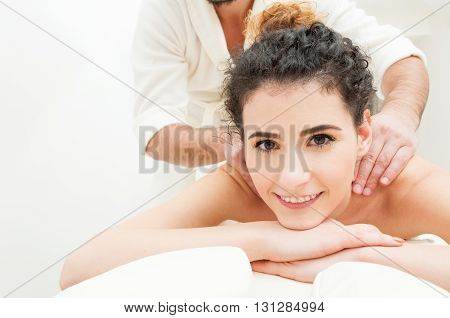 Close-up Of Smiling Woman Getting A Relaxing Massage