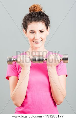 Yound Woman Doing Weight Training With Dumbbells