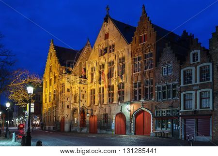 Street with historic houses in Bruges city center at evening Belgium