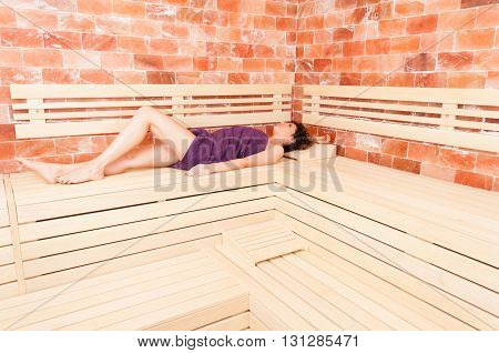 Beautiful Woman Lying On Back On Wooden Bench