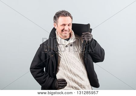 Young Man In Winter Clothes Holding His Jacket