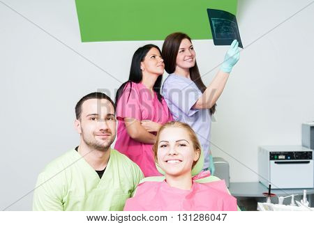 Dental Medical Team With Patient And X-ray