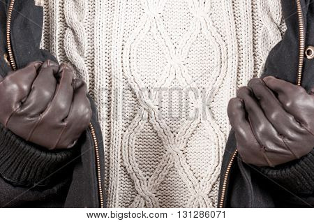 Close-up Of Warm Jumper With Jacket And Gloves