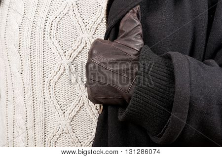 Close-up Of Man Glove, Black Jacket And Knitted Sweater