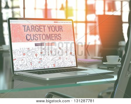 Modern Workplace with Laptop Showing Landing Page in Doodle Design Style with Text Target Your Customers. Toned Image with Selective Focus. 3D Render.