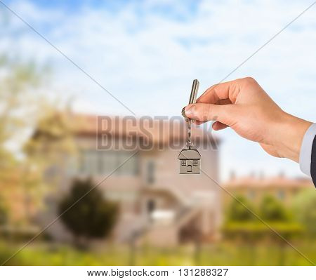 Estate agent giving house keys Working Conceptual Business Concept