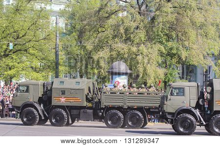 St. Petersburg, Russia - 9 May, Soldiers in military vehicles, 9 May, 2016. Festive military parade on the Palace Square in St. Petersburg.