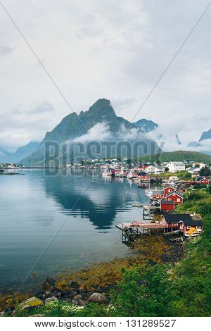 Scenic view of Reine - fishing village with red houses in the morning. Beauty of Rorbu, Lofoten islands, Norway