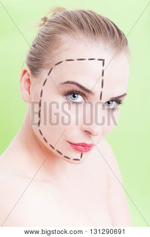 Beautiful Young Female Face With Facelift Marks Over Green Background