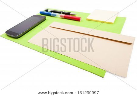 Office Desktop Design With Modern Cellphone And Writing Tools