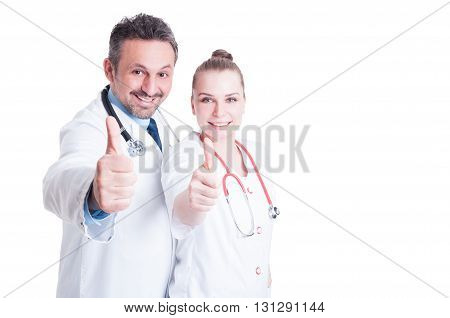 Excited Male And Woman Doctors Smiling And Showing  Thumbup