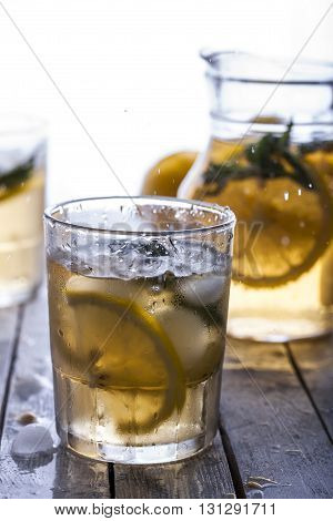 Lemonade in a glass with fresh lemon and mint