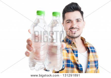 Close-up Of Bottles Of Water In Young Man Hands