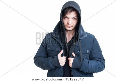 Portrait of young man wearing black hooded sweatshirt and jacket as urban outfit concept isolated on white