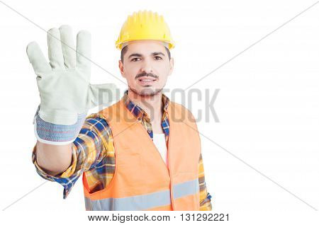 Cheerful Builder Showing Number Five Or Doing  High Five Gesture