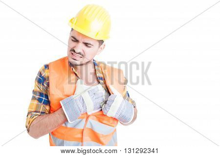 Portrait Of Young Constructor Holding His Chest In Pain