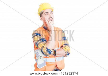Young Construction Worker Or Engineer Thinking And Looking Away