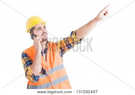 Attractive Engineer Pointing Finger Upwards While Using Cellphone
