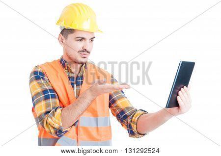 Handsome Engineer Sending Kisses Online Thru Modern Tablet