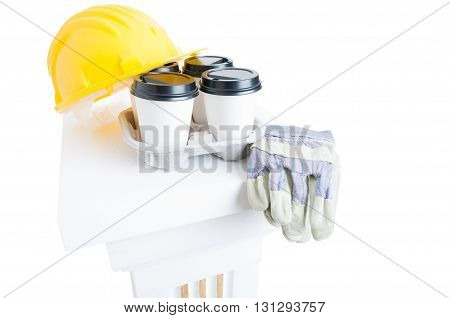 Close-up Coffee Cups And Safety Helmet And Gloves