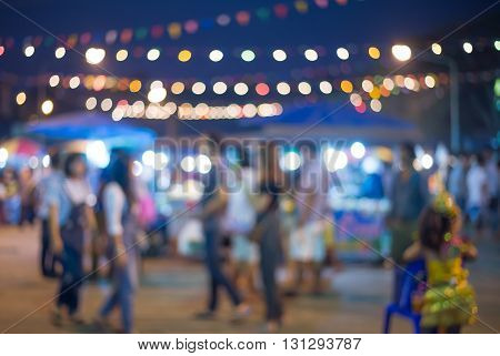 blurred picture of night market walking street in Thailand