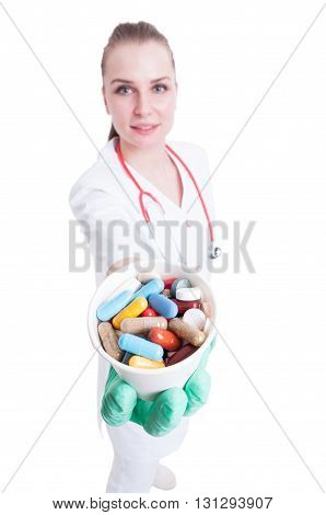 Vitamins Or Supplements Concept With Trustworthy Female Doctor Giving Pills