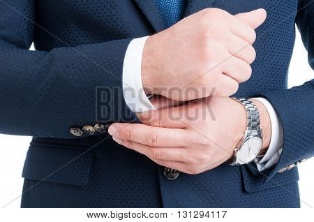 Businessman Fixing And Adjusting White Shirt Sleeve Under Blue Suit