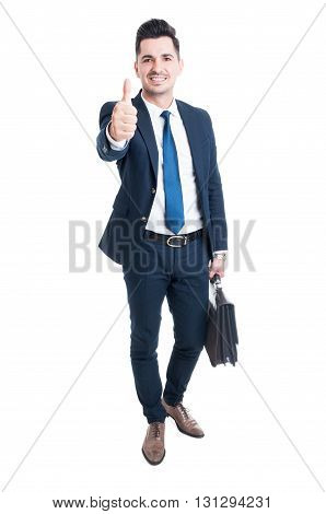 Confident businessman wearing blue suit and briefcase showing like standing isolated on white background