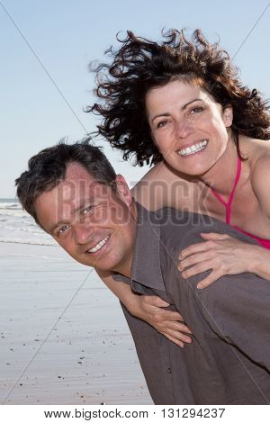 Loving Couple Together At Beach On Vacation