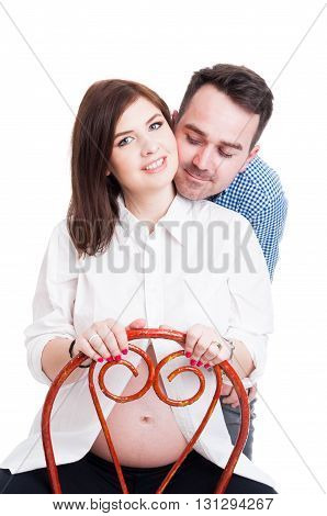Lovely Young Pregnant Woman With Her Husband Showing Affection