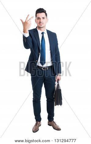 Sales Man Standing Holding Briefcase And Showing Number Three